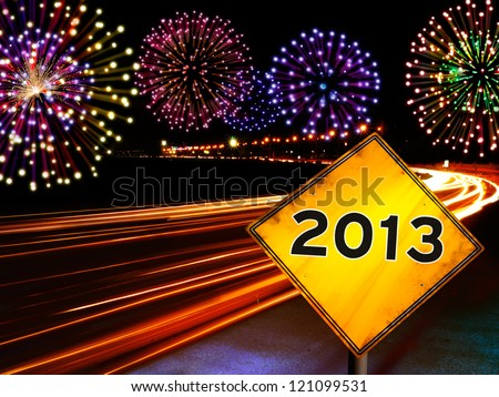 Happy New Year fireworks highway with 2013 year in yellow road sign ahead.