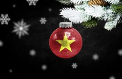 Happy new Year 2021, flag of Vietnam on a christmas toy, decorations isolated on dark background. Creative christmas concept.