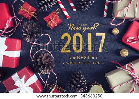 Happy New Year 2017. gift box with white ribbon on red velvet background. over light #543663250