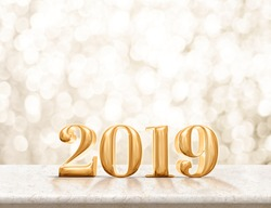 Happy new year 2019 gold glossy (3d rendering ) on marble table with sparkling gold bokeh wall,banner for display or montage of product for holiday promotion and advertise for online content.