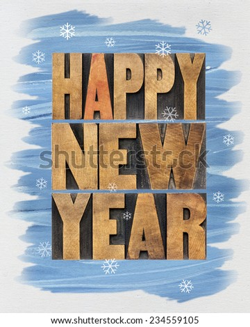 Happy New Year greetings or wishes - a collage of  text in vintage letterpress wood type blocks and watercolor painting on canvas