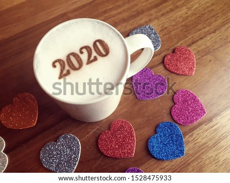 Happy new year 2020, heart shape with coffee latte art painting, key of success, unlock business in year2020.