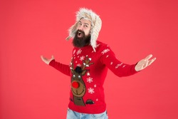 Happy new year. Join holiday party craze and host Ugly Christmas Sweater Party. Winter party outfit. Invitation ugly sweaters party. Sweater with deer. Hipster bearded man wear winter sweater and hat.