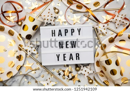 Happy new year lightbox celebration message with luxury gold party decorations