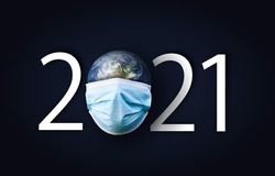 happy new year 2021 .mask on earth with 2021 sign Elements of this image furnished by NASA