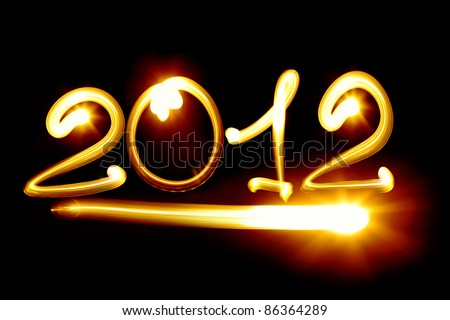 Happy new year 2012 message over black background