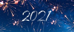 Happy new year 2021. New year celebration party with firecrackers, fireworks and rockets in a starry blue sky with the universe and a thousand stars. Future purposes, dreams and goals concept.