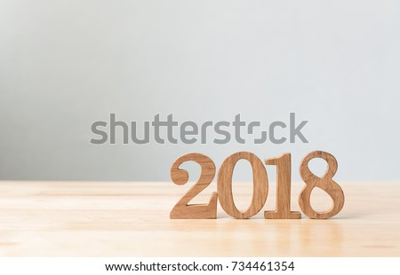 Happy new year 2018, Number wood material on wooden table with white wall background, Copy space #734461354