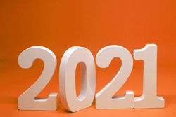 Happy new year 2021 , 2021 number wooden object on orange background and copy space - orange new year celebrate concept