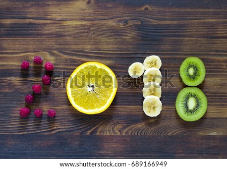 happy new year 2018 of fruit and berries on wooden background #689166949