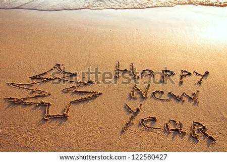 happy new year  on the beach - stock photo