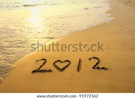 happy new year 2012 on the beach of sunrise