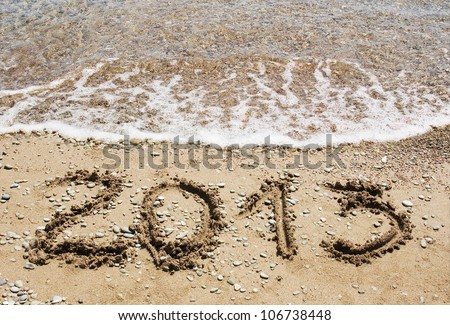 Happy New Year 2013 on the sea beach