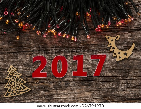Happy new year 2017 on wood background #526791970