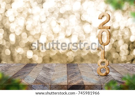 Happy new year 2018 on wood table and blur Christmas tree foreground at blur sparkling gold bokeh light wall,panoramic banner for display or montage of product,holiday seasonal #745981966
