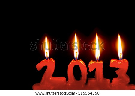 Happy new year 2013, red candles number burning in the dark
