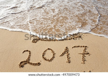Happy New Year 2017 replace 2016, lettering on the beach #497009473