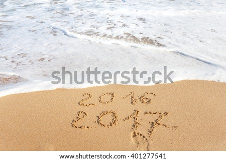 Happy New Year 2017 replace 2016 text on the sea beach #401277541