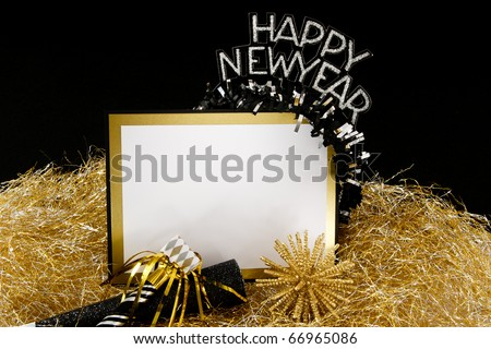 Happy New Year sign or invitation with copy-space in black and gold with traditional party favors