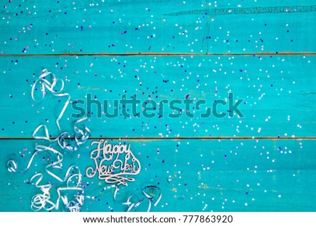 happy new year sign with holiday confetti and ribbon border on blank antique rustic teal blue
