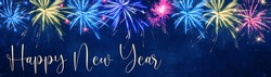 Happy New Year - Silvester background banner panorama long- Colorful firework on dark blue night sky texture, with space for text