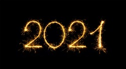Happy New Year 2021. Sparkling burning numbers Year 2021 isolated on black background. Beautiful Glowing golden overlay object for design holiday greeting card, billboard and Web banner
