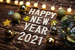 Happy New Year 2021. Symbol from number 2021 on wooden background