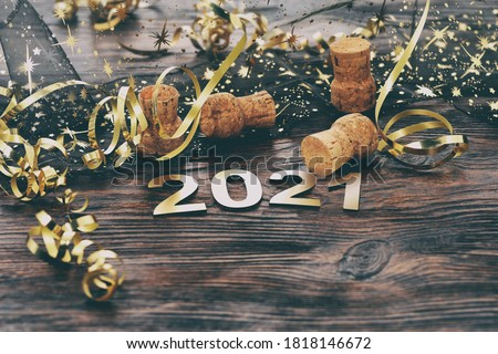 Happy New Year. Symbol from number 2021 on wooden background