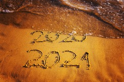 Happy new year 2021 text by the sea. Selective focus. Abstract background photography of the approaching New Year 2021 and the outgoing 2020