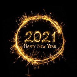 Happy New Year 2021. Text Happy New Year 2021 written sparkling sparklers isolated on black background for design. Beautiful Glowing overlay template for holiday greeting card.