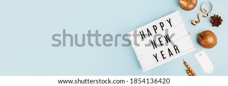 Happy New Year Text Light Box. Panorama Banner. Goodbye 2020 Concept Wide Angle Image On Blue Background. Abstract Celebration Concept With Copy Space For Message.