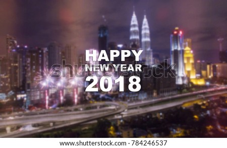 Happy New Year 2018 text on blurred metro city background at night with beautiful firework.Night city scape with fireworks. #784246537