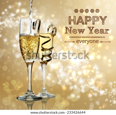Happy New Year text with champagne glasses