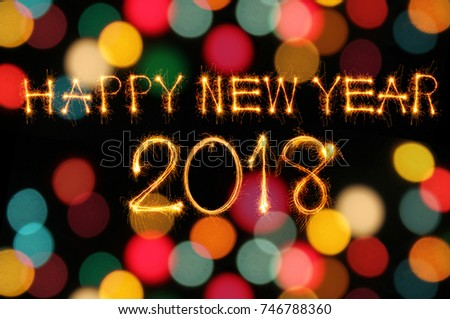 happy new year 2018 text written with sparkle fireworks isolated on black background 746788360