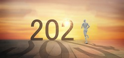 Happy New year 2021 trend concept.automation robot run to number 2021 in the new year of hope , beginning, new job start new life with 2021 sunrise backgroud