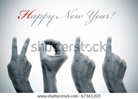 happy new year with hands forming number 2011
