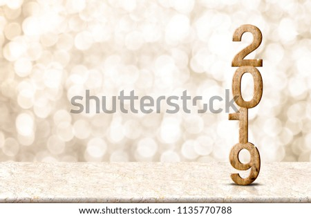 Happy New Year 2019 wood with sparkling star on marble table with gold bokeh background,Holiday festive celebration concept.copy space for display of text or content #1135770788