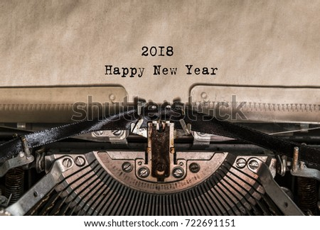 Happy New Year 2018 words typed on a Vintage Typewriter. Mechanisms closeup. Typing on old typewriter. Greeting card with a holiday #722691151