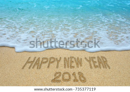 Happy new year 2018 written on sandy beach, New Year 2018 is coming concept. #735377119