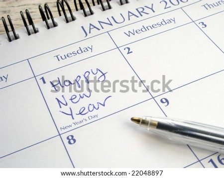 Happy New Year written on 1st January on a calendar.