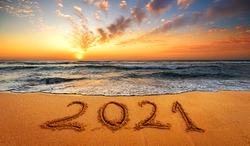 Happy New Year 2021! Written 2021 on the beach. Happy New Year 2021 is coming concept sandy.f