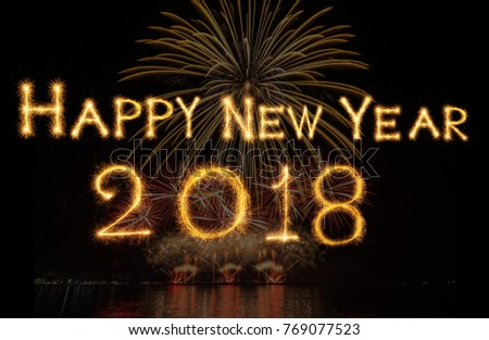 happy new year 2018 written with sparkle firework on fireworks with dark background celebration and