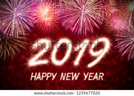Happy new year 2019 written with Sparkle firework with firework background #1239677020