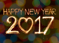 Happy new year 2017 written with Sparkling  light on bokeh background
