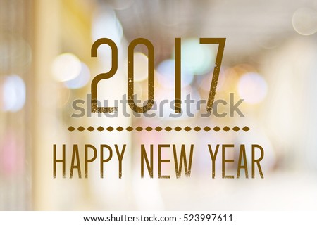 Happy New Year 2017 year on abstract blur festive bokeh background, banner, new year card