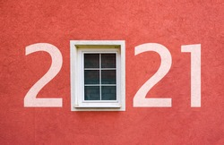 Happy new year 2021. Year 2021 on wall with window