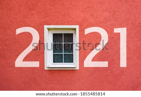 Happy new year 2021. Year 2021 on wall with window stock photo