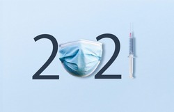 happy new year 2021. year 2021 with Medical protective Surgical mask and Vaccine