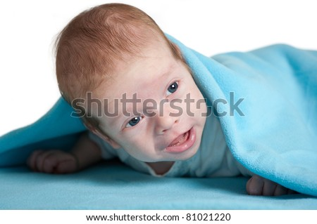 happy newborn baby covered in blue blanket, isolated on white background
