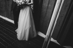 Happy newlywed couple b&w wedding dress